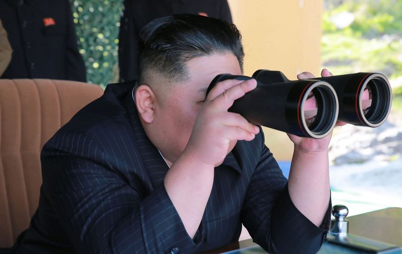 """This May 9, 2019 picture released from North Korea's official Korean Central News Agency (KCNA) on May 10, 2019 shows North Korean leader Kim Jong-Un attending the strike drill of defence units of the Korean People's Army (KPA) in the forefront area and on the western front of North Korea. (Photo by KCNA VIA KNS / various sources / AFP) / South Korea OUT / ---EDITORS NOTE--- RESTRICTED TO EDITORIAL USE - MANDATORY CREDIT """"AFP PHOTO/KCNA VIA KNS"""" - NO MARKETING NO ADVERTISING CAMPAIGNS - DISTRIBUTED AS A SERVICE TO CLIENTS / THIS PICTURE WAS MADE AVAILABLE BY A THIRD PARTY. AFP CAN NOT INDEPENDENTLY VERIFY THE AUTHENTICITY, LOCATION, DATE AND CONTENT OF THIS IMAGE --- /"""