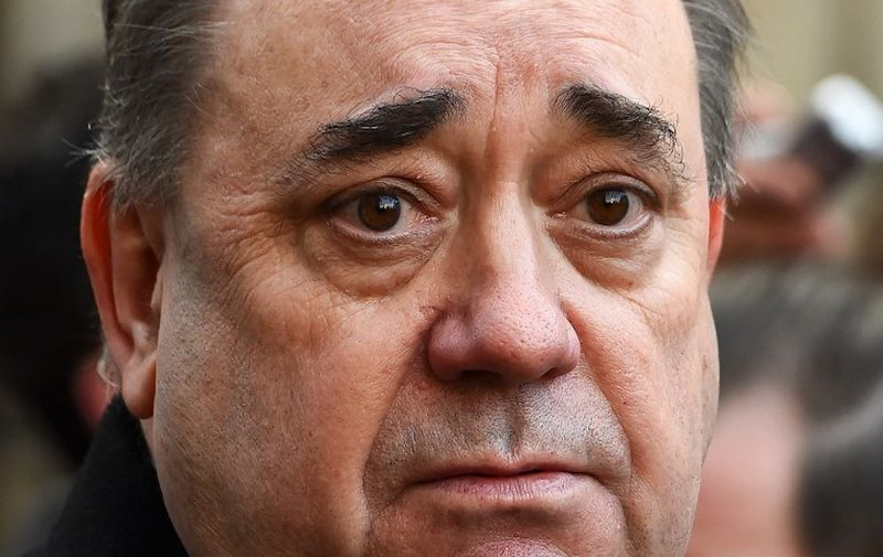 (FILES) In this file photo taken on January 08, 2019 former First Minister of Scotland Alex Salmond addresses the media outside the Court Of Session in Edinburgh after winning a case he brought against the Scottish Government over their handling of sexual misconduct allegations against him. - Former Scottish first minister and pro-independence figurehead Alex Salmond was on Thursday arrested and charged in a probe over allegations of sexual harassment, police said. (Photo by Andy Buchanan / AFP)