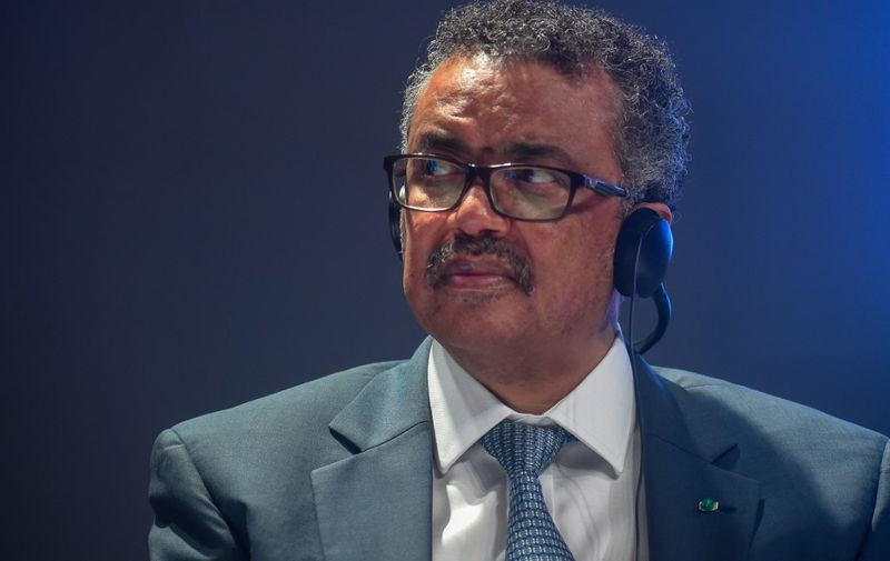 World Health Organization (WHO) Director-general Tedros Adhanom Ghebreyesus (R) looks on during the Tony Elumelu Foundation's African entrepreneurship forum in Abuja, Nigeria on July 26, 2019. - The Tony Elumelu Foundation hosts every year the largest gathering of startup entrepreneurs, policymakers, development institutions, business leaders and motivation speakers to debate and interact with a view to connect, forge networks and partnerships. (Photo by PIUS UTOMI EKPEI / AFP)