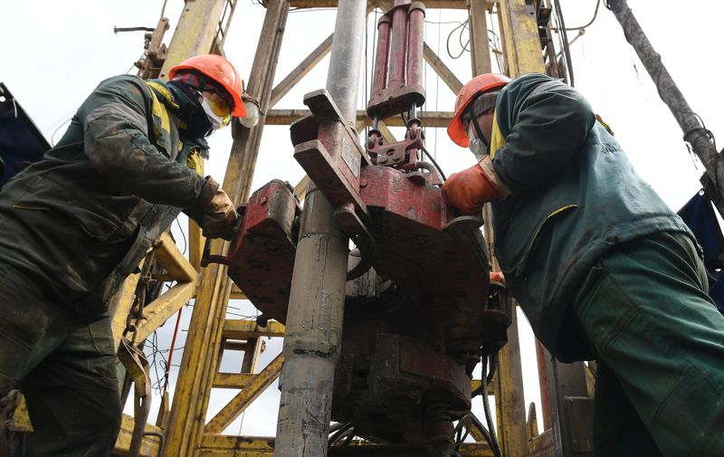 6246908 21.05.2020 Employees work on a drilling rig at an oil field owned by Russia's oil producer Tatneft near Almetyevsk, in the Republic of Tatarstan, Russia.,Image: 521258912, License: Rights-managed, Restrictions: , Model Release: no