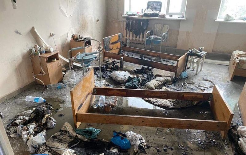 """A view of a ward of hospital in western Ukrainian city of Chernivtsi after fire was caused by a blast on February 27, 2021. - One person was killed and another one injured in Ukraine after a fire tore through a hospital that was treating coronavirus patients, emergency services said on February 27, 2021. The fire was caused by a blast that took place in a ward on the first floor of a five-story hospital building in southwestern city of Chernivtsi emergency services said. It said in a statement that in """"a oxygen pipe flash"""" followed by the fire one person was killed and another one injured. (Photo by STR / AFP)"""