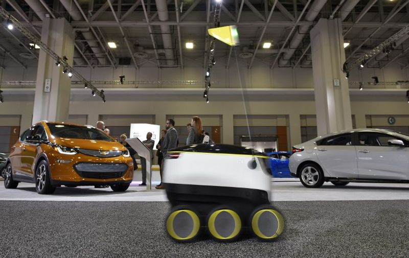 """A January 26, 2017 photo shows the Starship Technologies delivery robot at the Washington Auto Show in Washington, DC. The robots of the future will be coming soon, rolling along at lumbering pace, with those goods you just ordered. The six-wheeled, knee-high robots from startup Starship Technologies are part of a new wave of automated systems taking aim at the """"last mile"""" delivery of goods to consumers.  / AFP PHOTO / Mandel Ngan / TO GO WITH AFP STORY BY ROB LEVER -""""New wave of robots set to deliver the goods"""""""