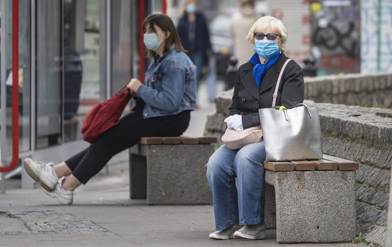 People wearing protective masks are seen on the streets of Warsaw after the Polish government tightened restrictions in the fight against the coronavirus and introduced mandatory mouth and nose coverage in public places, on October 10, 2020. - Polish senior citizens will once again be able to do their shopping without contact with the rest of the population, with shops reserved for them for two hours each day, the Polish Prime Minister announced on Saturday following record increases in contamination. (Photo by Wojtek RADWANSKI / AFP)
