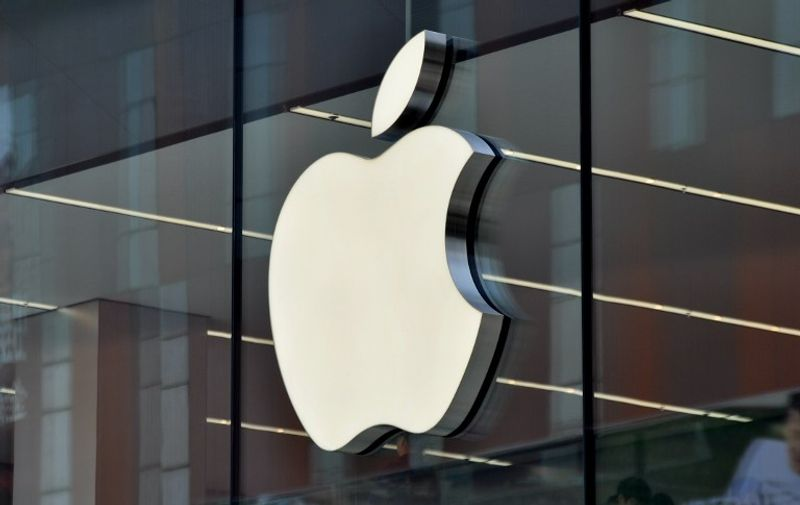 --FILE--The logo of Apple Inc. is on display on the glass facade of an Apple Store in Shenyang city, northeast China's Liaoning province, 10 May 2015.  Nasdaq OMX Group Inc. is seeking to tempt Shenzhen stock investors with Apple Inc. and Microsoft Corp. amid a rally in Chinese technology shares that's making the U.S. dot-com bubble look subdued. Nasdaq will start an exchange-traded fund in Shenzhen tracking the Nasdaq 100 Index by early in the third quarter, Robert Hughes, who manages the New York-based company's global indexes business, said in an interview on Wednesday (20 May 2015). It's licensed GF Fund Management Co. to offer the Guangfa Nasdaq-100 Index Fund, which will be Shenzhen's first ETF based on the gauge, he said. The rally that's added more than $5 trillion to the value of Chinese equities over the past year has been even more pronounced in Shenzhen, where the market is dominated by smaller technology companies.