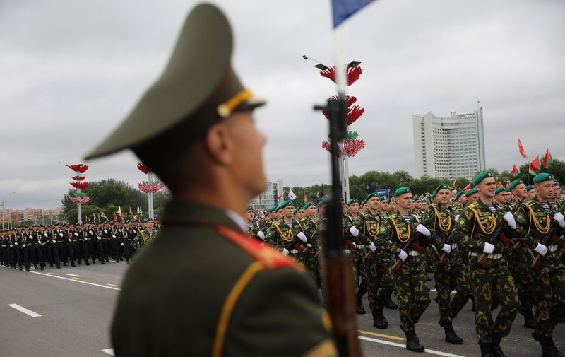 MINSK, BELARUS - JULY 03:  Troops march past Belarusian President Alexander Lukashenko during the annual Independence Day Parade on July 3, 2017 in Minsk, Belarus. The parade included around 6000 military personnel, 500 vehicles and military hardware, transport and combat aircraft, combat helicopters and an array of farming vehicles including tractors. Independence Day, also known as the Day of the Republic is marked as an official national public holiday, commemorating the anniversary, when the capital, Minsk was liberated by Soviet troops from Nazi occupation during World War II.  (Photo by Dan Kitwood/Getty Images)
