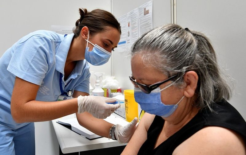 (210731) -- SARAJEVO, July 31, 2021 (Xinhua) -- A woman gets vaccinated at a COVID-19 vaccination center in Sarajevo, Bosnia and Herzegovina (BiH), July 31, 2021.,Image: 624544993, License: Rights-managed, Restrictions: , Model Release: no, Credit line: Profimedia