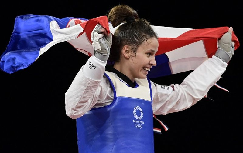 Croatia's Matea Jelic celebrates after winning the taekwondo women's -67kg gold medal bout during the Tokyo 2020 Olympic Games at the Makuhari Messe Hall in Tokyo on July 26, 2021. (Photo by Javier SORIANO / AFP)