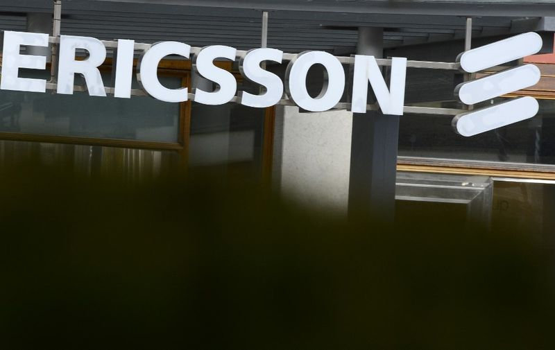 (FILES) In this file photo taken on November 7, 2012, shows Swedish provider of telecommunications equipment and data communication systems giant Ericsson logo at the Ericsson headquarters in Stockholm's suburb of Kista. - Swedish telecoms firm Ericsson has agreed to pay more than USD 1 billion to resolve allegations of bribery in countries around the world, the US Justice Department announced on December 6, 2019. (Photo by Jonathan NACKSTRAND / AFP)