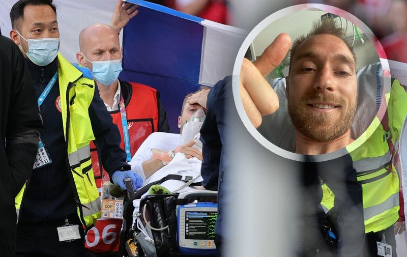 Denmark's midfielder Christian Eriksen (C) is evacuated after collapsing on the pitch during the UEFA EURO 2020 Group B football match between Denmark and Finland at the Parken Stadium in Copenhagen on June 12, 2021. (Photo by Friedemann Vogel / various sources / AFP)