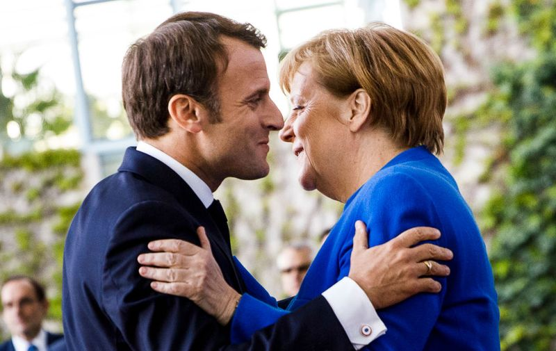 BERLIN, GERMANY - APRIL 29: German Chancellor Angela Merkel greets French President Emmanuel Macron upon his arrival at the Chancellery for the Western Balkans Conference on April 29, 2019 in Berlin, Germany. German Chancellor Angela Merkel and French President Emmanuel Macron are hosting the conference that includes the leaders of North Macedonia, Albania, Croatia, Bosnia-Herzegovina, Serbia, Kosovo, Montenegro and Slovenia. (Photo by Carsten Koall/Getty Images)