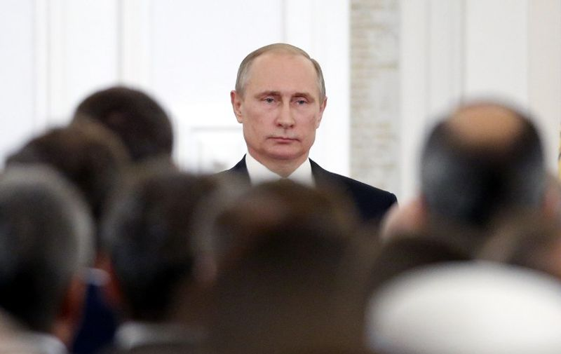 Russian President Vladimir Putin attends the State Prize awards ceremony marking the 'Day of Russia' at the Grand Kremlin Palace in Moscow, on June 12, 2016.   Eight people were awarded for their significant contribution to the scientific, cultural and humanitarian fields. Since 1992 the 'Day of Russia' is anually celebrated on 12 June as the Russian Federation's national holiday. / AFP PHOTO / POOL / MAXIM SHIPENKOV