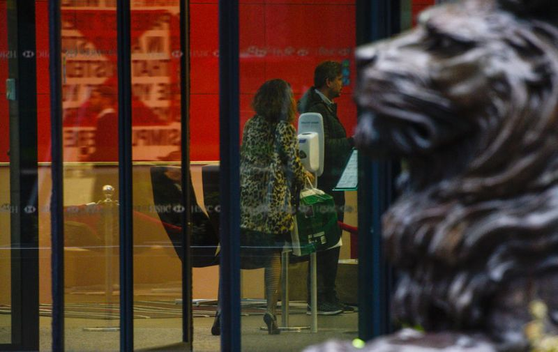 LONDON, ENGLAND - MARCH 05: A woman uses hand sanitiser inside the HSBC tower at Canary Wharf on March 5, 2020 in London, England. HSBC cleared the research department earlier today, Thurs, after a worker tested positive for Covid-19. There are 90 confirmed cases of coronavirus in the UK. (Photo by Peter Summers/Getty Images)