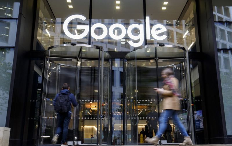People walk past Google's UK headquarters in London on November 1, 2018. - Hundreds of employees walked out of Google's European headquarters in Dublin on Thursday as part of a global campaign over the US tech giant's handling of sexual harassment that saw similar protests in London and Singapore. (Photo by Tolga Akmen / various sources / AFP)