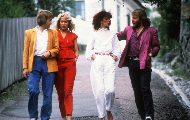 Swedish pop group Abba (from L to R) Bjorn Ulvaeus, Agnetha Faltskog, Anni-frid Lyngstad and Benny Andersson, walks in the streets of Marstrand, July 15, 1980 in Sweden. (Photo by ROGER TURESSON / SCANPIX SWEDEN / AFP)