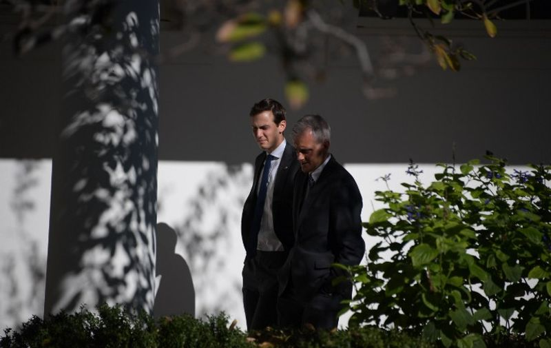 White House Chief of Staff Denis McDonough (R) and Jared Kushner, an aid of Republican presidential nominee Donald Trump are seen at the White House November 10, 2016.   US President Barack Obama met Republican President-elect Donald Trump on transition planning in the Oval Office.  / AFP PHOTO / JIM WATSON