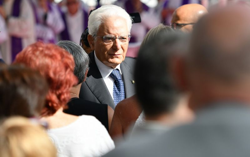 Italy's President Sergio Mattarella meets victims' relatives prior to the mass for the first anniversary of the collapse of the Morandi bridge, on August 14, 2019 in Genoa. - Italy on August 14, 2019 marks a year since the Genoa motorway bridge collapse that killed 43 people, as the country grapples with a political crisis sparked by far-right leader. The ceremony takes place close to the spot where a section of the Morandi highway fell during heavy rain on August 14, 2018, hurling dozens of cars and several trucks onto railway tracks below. (Photo by Alberto PIZZOLI / AFP)