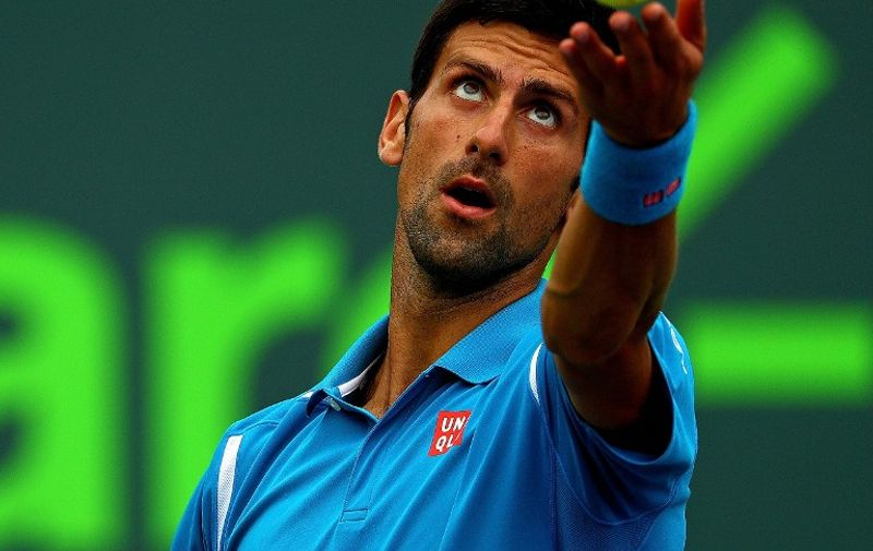 KEY BISCAYNE, FL - APRIL 03: Novak Djokovic of Serbia plays in the Men's Final against Kei Nishikori of Japan during Day 14 of the Miami Open presented by Itau at Crandon Park Tennis Center on April 3, 2016 in Key Biscayne, Florida.   Mike Ehrmann/Getty Images/AFP