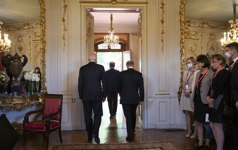 Swiss Federal president Guy Parmelin (C) US president Joe Biden (L) and Russian president Vladimir Putin walk out to meet the media after their arrival at the villa La Grange, during the US - Russia summit in Geneva, on June 16, 2021. (Photo by PETER KLAUNZER / POOL / AFP)