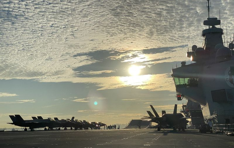 Fighter jets are park on the flight deck onboard UK Carrier Strike Group's HMS Queen Elizabeth docked at Changi Naval Base in Singapore on October 11, 2021. (Photo by CATHERINE LAI / AFP)
