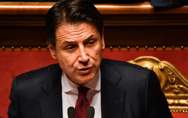 """Italian Prime Minister Giuseppe Conte delivers a speech at the Italian Senate, in Rome, on August 20, 2019, as the country faces a political crisis. - Italy's far-right Interior Minister Matteo Salvini was """"irresponsible"""" to spark a political crisis by pulling the plug on the governing coalition, Prime Minister Giuseppe Conte told the Senate. """"It is irresponsible to initiate a government crisis,"""" Conte said. """"It shows personal and party interests."""" (Photo by Andreas SOLARO / AFP)"""