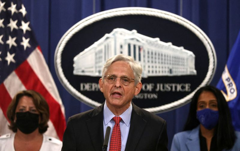 WASHINGTON, DC - SEPTEMBER 09: U.S. Attorney General Merrick Garland (C) speaks as Deputy Attorney General Lisa Monaco (L) and Associate Attorney General Vanita Gupta (R) listen during a news conference to announce a civil enforcement action at the Department of Justice on September 9, 2021 in Washington, DC. Attorney General Garland said the Department of Justice is filing a lawsuit against the state of Texas over the state's restrictive law to ban almost all abortions.   Alex Wong/Getty Images/AFP (Photo by ALEX WONG / GETTY IMAGES NORTH AMERICA / Getty Images via AFP)