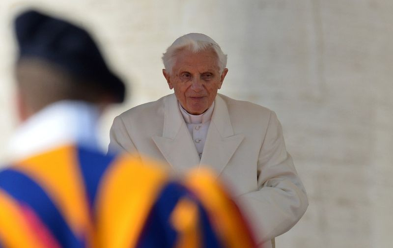 Pope Benedict XVI blesses faithful before leaving the altar at the end of his last weekly audience on February 27, 2013 at St Peter's square at the Vatican. Pope Benedict XVI will hold the last audience of his pontificate in St Peter's Square on Wednesday on the eve of his historic resignation as leader of the world's 1.2 billion Catholics.      AFP PHOTO / GABRIEL BOUYS (Photo by GABRIEL BOUYS / AFP)