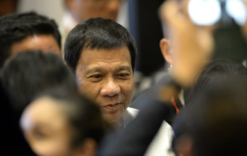 Philippine President Rodrigo Duterte arrives for the Association of Southeast Asian Nations (ASEAN) Business and Investment Summit in Vientiane on September 6, 2016. The gathering will see the 10 ASEAN members meet by themselves, then with leaders from the US, Japan, South Korea and China.  / AFP PHOTO / NOEL CELIS