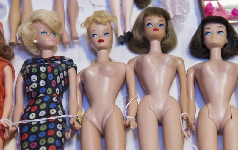 Barbie dolls are seen for sale during the 2015 National Barbie Doll Collectors Convention in Arlington, Virginia on July 30, 2015. Over 1000 fans attended the gala event that had shows, special guests, competitions, fashion shows and sale of everything for Barbie.   AFP PHOTO/PAUL J. RICHARDS (Photo by PAUL J. RICHARDS / AFP)