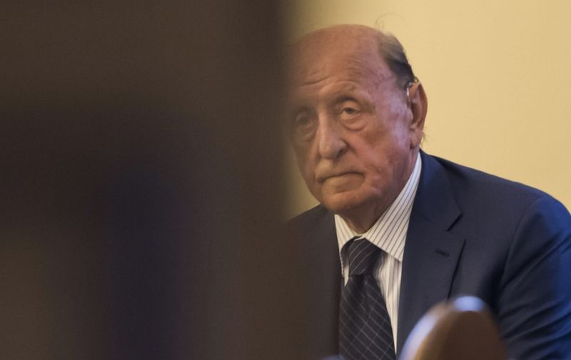 """(FILES) In this file photo handout taken and handout on May 09, 2018 by the Vatican Media, former president of the IOR Vatican bank, Angelo Caloia is pictured during a court hearing on embezzlement charges at the Vatican. - Angelo Caloia, a former head of the Vatican bank, was on January 21, 2021 found guilty of embezzlement and money laundering and sentenced to eight years and 11 months in prison. (Photo by Handout / VATICAN MEDIA / AFP) / RESTRICTED TO EDITORIAL USE - MANDATORY CREDIT """"AFP PHOTO / VATICAN MEDIA"""" - NO MARKETING - NO ADVERTISING CAMPAIGNS - DISTRIBUTED AS A SERVICE TO CLIENTS"""