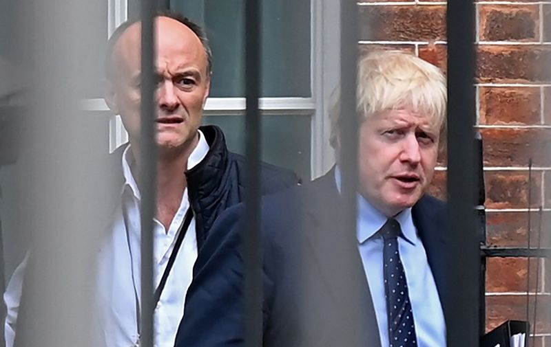 (FILES) In this file photo taken on September 03, 2019 Britain's Prime Minister Boris Johnson (R) and his special advisor Dominic Cummings leave from the rear of Downing Street in central London, before heading to the Houses of Parliament. - One of British Prime Minister Boris Johnson's top advisers, Dominic Cummings, drew police attention after allegedly breaking the coronavirus lockdown, reports said on May 22. Cummings left his London home to stay with his parents in Durham, northeast England, while suffering symptoms of COVID-19, the Daily Mirror and The Guardian newspapers said. (Photo by DANIEL LEAL-OLIVAS / AFP)