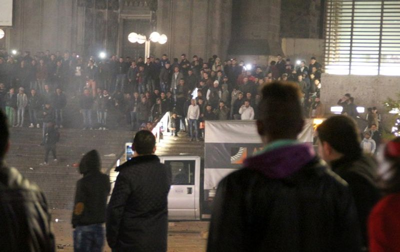 Picture taken on December 31, 2015 shows people gathering in front of the main railway station in Cologne, western Germany. Police in Cologne told AFP they have received more than 100 complaints by women reporting assaults ranging from groping to at least one reported rape, allegedly committed in a large crowd of revellers during year-end festivities outside the city's main train station and its famed Gothic cathedral. / AFP / dpa / Markus Boehm / Germany OUT