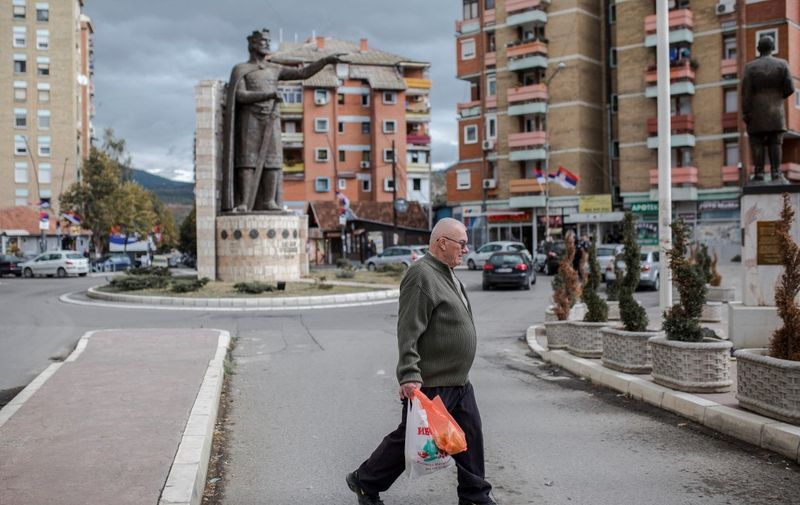 A man walks past the monument of late Serbian Duke Lazar, who was was killed in the Battle of Kosovo in June 1389, in the northern part of the divided city of Mitrovica on October 6, 2019. - Kosovo went to the polls on October 6, 2019 in an election that could usher in new leadership at a time when stalled talks with former war foe Serbia are a source of instability in Europe. (Photo by Vladimir Zivojinovic / AFP)