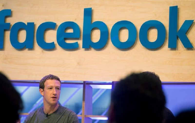 """Facebook founder and chief Mark Zuckerberg speaks at the so-called """"Facebook Innovation Hub"""" in Berlin on February 25, 2016.  Facebook announced it was donating computer servers to a number of research institutions across Europe, starting with Germany, to accelerate research efforts in artificial intelligence (AI) and machine learning. / AFP PHOTO / dpa / Kay Nietfeld / Germany OUT"""