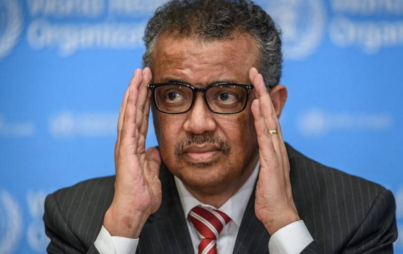 EDITORS NOTE: Graphic content / World Health Organization (WHO) Director-General Tedros Adhanom Ghebreyesus attends a daily press briefing on COVID-19 virus at the WHO headquaters on March 11, 2020 in Geneva. - WHO Director-General Tedros Adhanom Ghebreyesus announced on March 11, 2020 that the new coronavirus outbreak can now be characterised as a pandemic. (Photo by Fabrice COFFRINI / AFP)