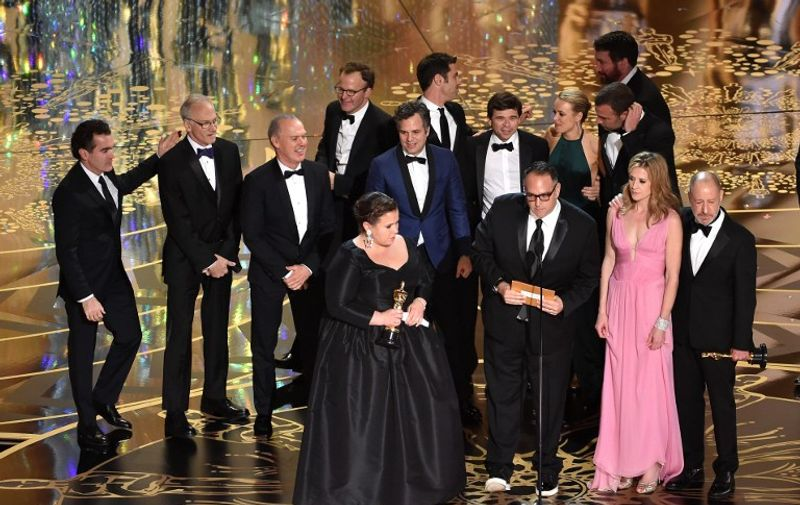 HOLLYWOOD, CA - FEBRUARY 28: Cast and crew of 'Spotlight,' including actors Brian d'Arcy James, Michael Keaton, writer-director Tom McCarthy, actor Mark Ruffalo, producers Nicole Rocklin and Blye Pagon Faust, screenwriter Josh Singer, producer Michael Sugar, actors Rachel McAdams and Liev Schreiber, and producer Steve Golin accept the Best Picture award onstage during the 88th Annual Academy Awards at the Dolby Theatre on February 28, 2016 in Hollywood, California.   Kevin Winter/Getty Images/AFP