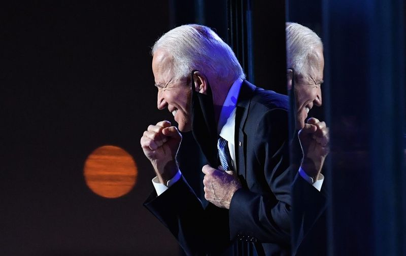 US President-elect Joe Biden gestures to the crowd after he delivered remarks in Wilmington, Delaware, on November 7, 2020. - Democrat Joe Biden was declared winner of the US presidency November 7, defeating Donald Trump and ending an era that convulsed American politics, shocked the world and left the United States more divided than at any time in decades. (Photo by Angela Weiss / AFP)