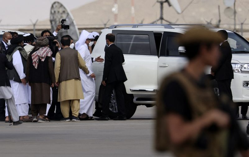 Qatari Deputy Prime Minister and Foreign Minister Mohammed bin Abdulrahman al-Thani (C) boards on a car upon his arrival at the airport in Kabul on September 12, 2021. (Photo by Karim SAHIB / AFP)