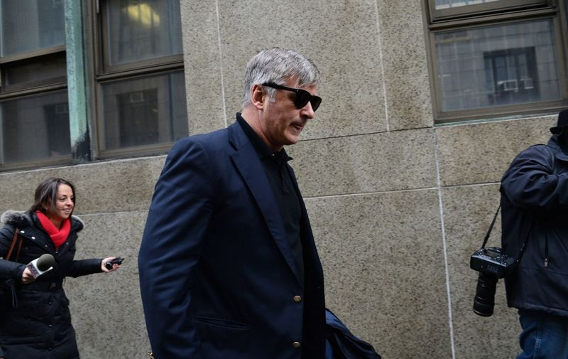 Actor Alec Baldwin leaves Manhattan Criminal Court after testifying against accused stalker Canadian actress Genevieve Sabourin November 12, 2013  in New York. AFP PHOTO/Stan HONDA (Photo by STAN HONDA / AFP)