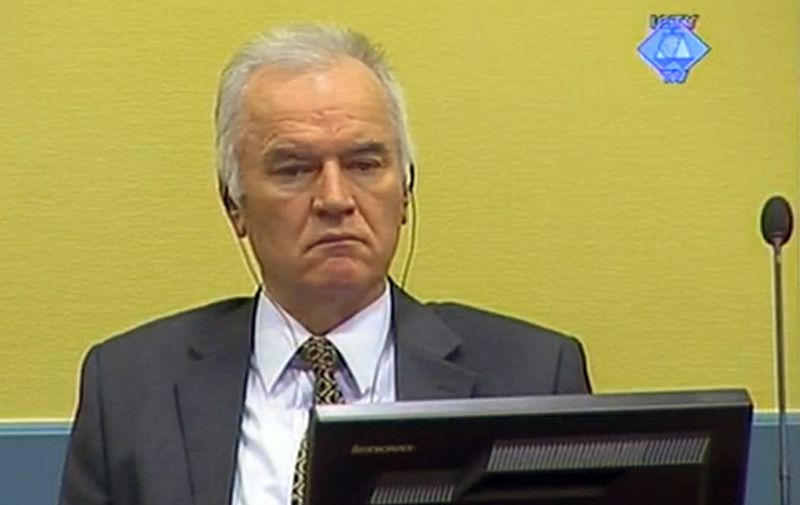 "A screen grab released by the International Criminal Tribunal for the former Yugoslavia (ICTY) shows former Bosnian Serb army chief Ratko Mladic sitting in the courtroom on May 16, 2012 in The Hague. The trial of wartime Bosnian Serb army chief Ratko Mladic opened before a UN court Wednesday, where he faces charges for some of the worst atrocities committed in Europe since World War II. Mladic, 70, faces 11 overall counts for genocide, war crimes and crimes against humanity which include masterminding the massacre of almost 8,000 men and boys at Srebrenica in 1995. AFP PHOTO / COURTESY OF THE ICTY RESTRICTED TO EDITORIAL USE - MANDATORY CREDIT ""AFP PHOTO / COURTESY OF THE ICTY"" - NO MARKETING NO ADVERTISING CAMPAIGNS - DISTRIBUTED AS A SERVICE TO CLIENTS"