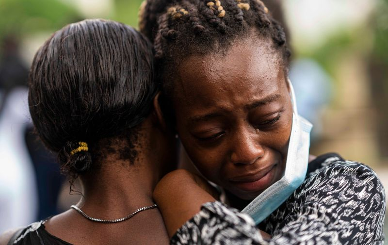 (210822) -- LES CAYES, Aug. 22, 2021 (Xinhua) -- A woman cries when attending a funeral of her relative died of the earthquake in Marceline, near Les Cayes, Haiti, on Aug. 21, 2021.,Image: 628301945, License: Rights-managed, Restrictions: , Model Release: no, Credit line: Profimedia