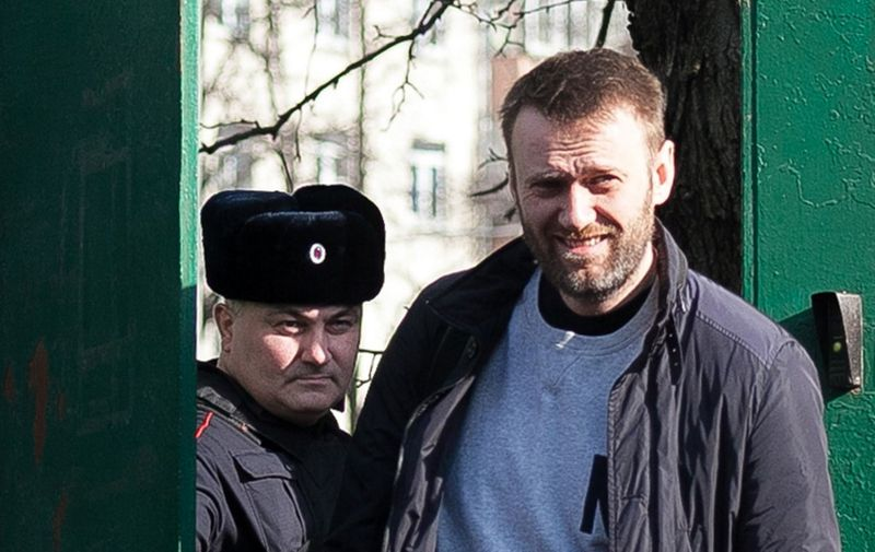 Russian anti-Kremlin opposition leader Alexei Navalny (R) leaves a detention centre in Moscow on March 6, 2015. Navalny was jailed on February 19 for 15 days for handing out flyers advertising the March 1 protest in the capital's subway. AFP PHOTO / PHILIPP KIREEV (Photo by PHILIPP KIREEV / AFP)