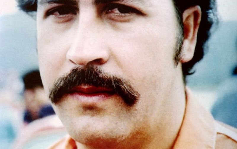 This undated file photo shows jailed Medellin drugs cartel leader Pablo Escobar who has been held at the Envigado Prison since June 19, 1991. Prison officials report that Escobar and his brother Roberto barricaded themselves in an underground tunnel in the prison late July 21 after the Colombian Justice department ordered their transfer to a military base near Medellin. (Photo by AFP)