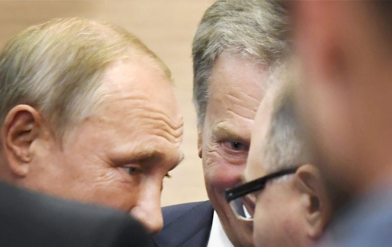 President of the Russian Federation Vladimir Putin (left) and President of Finland Sauli Niinistö (middle) talking together at the press conference. President of Finland Sauli Niinisto visit to Sochi, Russia - 22 Aug 2018,Image: 383665047, License: Rights-managed, Restrictions: , Model Release: no