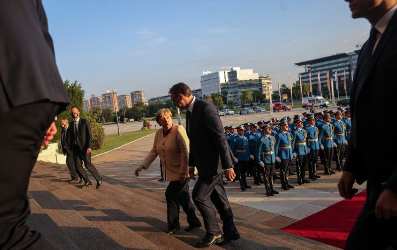 German Chancellor Angela Merkel (2nd R) and Serbian President Aleksandar Vucic (R) inspect a military guard of honour prior to their meeting in Belgrade, Serbia, on September, 13, 2021. - Angela Merkel is on a three-day visit to the Balkan States of Serbia and Albania. (Photo by OLIVER BUNIC / AFP)