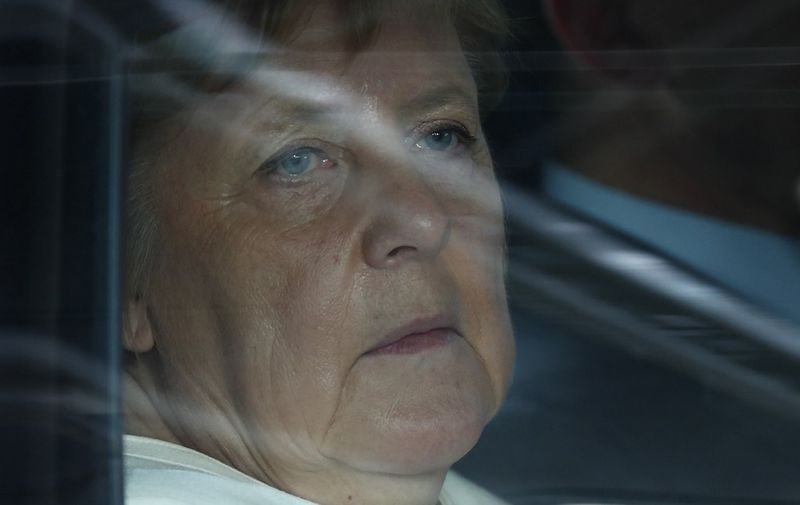 Germany's Chancellor Angela Merkel arrives for an European Council Summit at The Europa Building in Brussels, on June 30, 2019. - Deadlocked EU leaders meet for a rare weekend summit seeking to fill senior European positions and settle a battle that has split key allies France and Germany. (Photo by FRANCOIS LENOIR / POOL / AFP)
