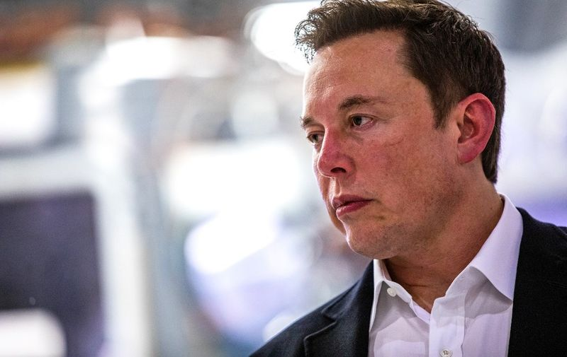 SpaceX founder Elon Musk addresses the media during a press conference announcing new developments of the Crew Dragon reusable spacecraft, at SpaceX headquarters in Hawthorne, California on October 10, 2019. (Photo by Philip Pacheco / AFP)