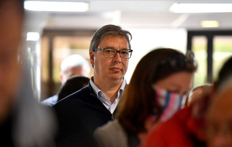 Serbian President Aleksandar Vucic waits in line to cast his ballot at a polling station in Belgrade on June 21, 2020 during an election for a new parliament in Europe's first national election since the coronavirus pandemic, though few expect major surprises with the ruling party poised to dominate a scattered opposition, some of whom are boycotting the ballot. (Photo by ANDREJ ISAKOVIC / AFP)