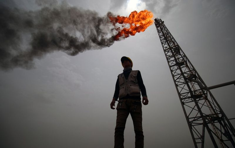 An employee stands at the Hammar Mushrif new Degassing Station Facilities site inside the Zubair oil and gas field, north of the southern Iraqi province of Basra on May 9, 2018. (Photo by HAIDAR MOHAMMED ALI / AFP)