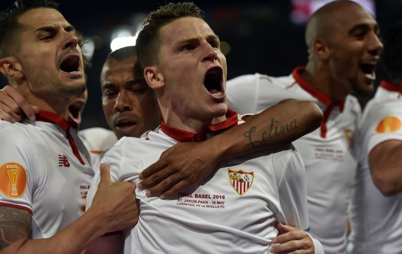 Sevilla's French forward Kevin Gameiro celebrates after scoring a goal during the UEFA Europa League final football match between Liverpool FC and Sevilla FC at the St Jakob-Park stadium in Basel, on May 18, 2016.  AFP PHOTO / MICHAEL BUHOLZER / AFP PHOTO / MICHAEL BUHOLZER