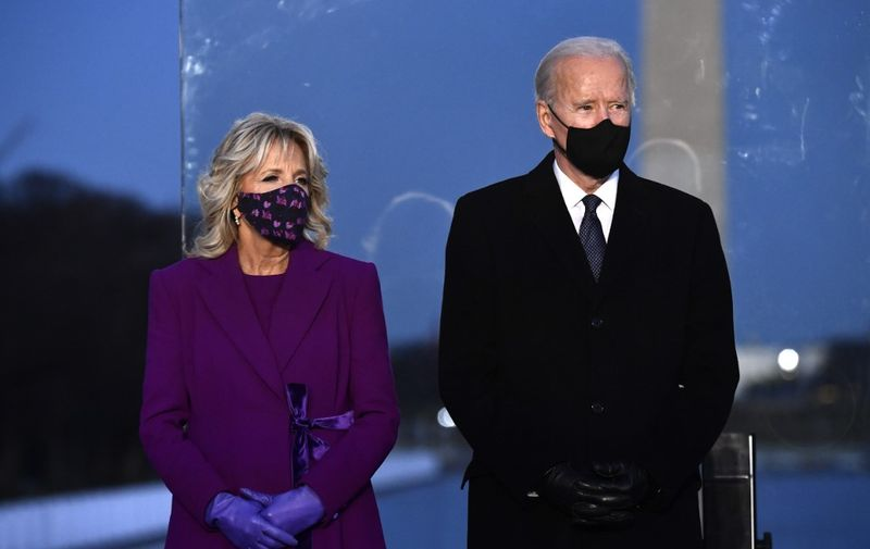 US President-elect Joe Biden and wife Dr. Jill Biden attend a Covid-19 Memorial at the Lincoln Memorial in Washington, DC, on January 19, 2021 to honor the lives of those lost to Covid-19. (Photo by Patrick T. FALLON / AFP)